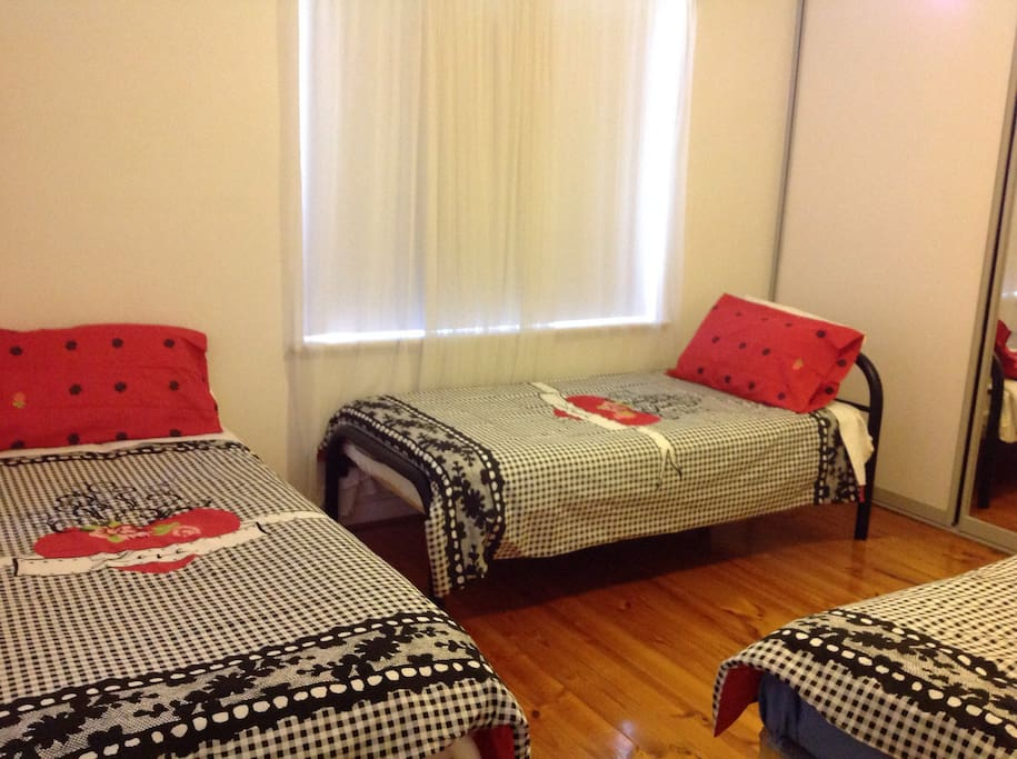 This room can be co figured from 2-3 beds, as shown in this photo we have configured 3 beds. Bed linen will be changed to accommodate various guest .2 windows brings in natural light . This room has a ceiling fan .
