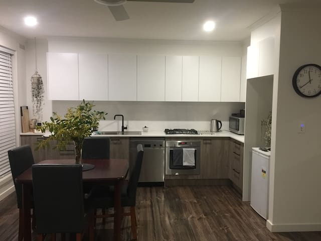 Beautifully appointed spacious kitchen with everything that you will need during your stay.  Miele dishwasher, Westinghouse oven and hotplates.  Rosewood extendable dining table.