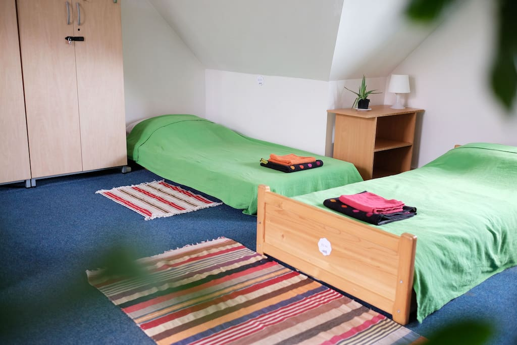 All beds come with green covers, fresh white linen and set of towels