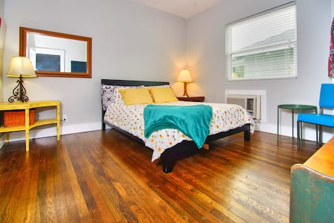 "Spacious size Queen bedroom with great natural lighting lots of storage, and beautifully restored 1920's original hardwood floors. Vintage handcrafted family furniture meets sleek new Scandinavian design.  Wall mounted 55"" Roku TV"
