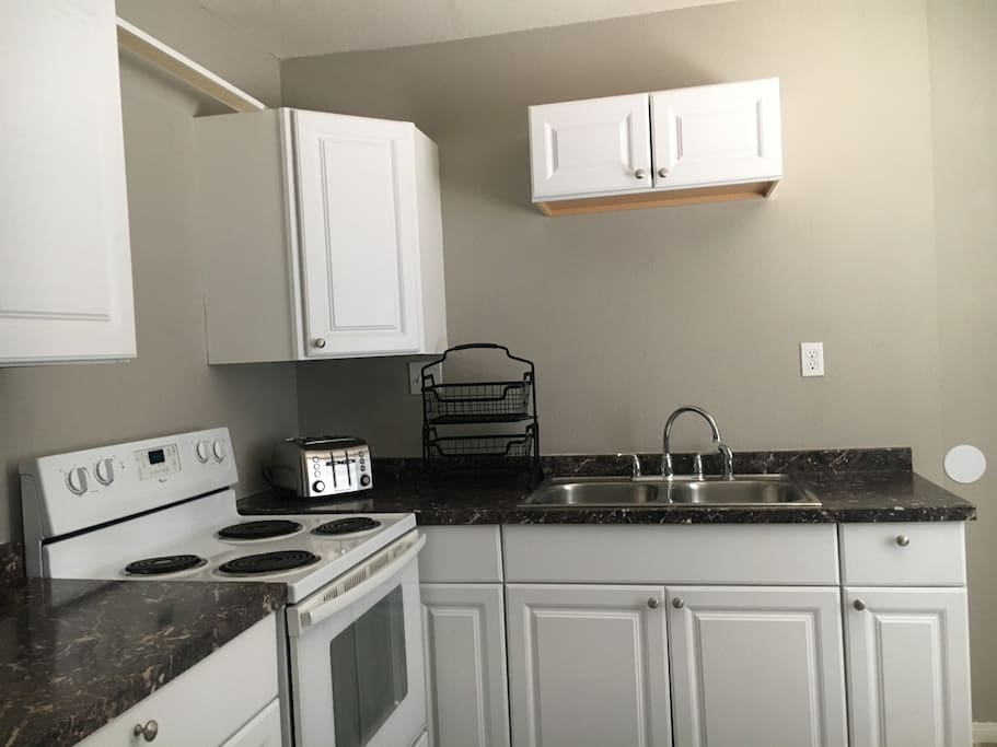 Full size equipped kitchen with refrigerator., we now have microwave, toaster, blender, coffee maker etc.