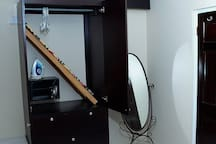 Iron board, iron, digital safe, hangers within the closet
