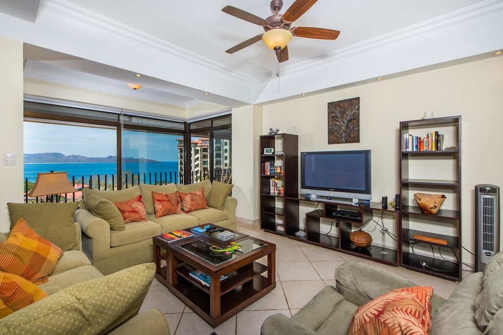 Sit, relax and watch the tv or the ocean from the living room