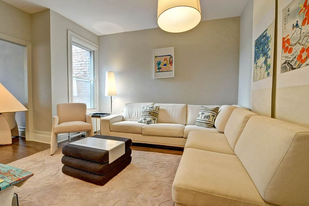 "Elegant & Bright living room with HD TV and Apple TV. Lovely view of the living room with a large ""L"" sofa. Enjoy a memorable night with family and friends."