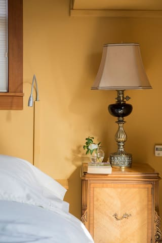 Adjustable bed lamps create the perfect setting for reading in bed at night.