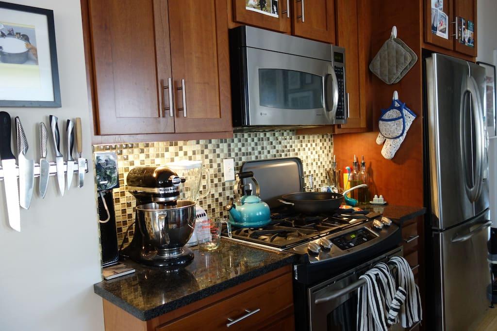 Stainless steel gas appliances, granite countertops, and Soda Stream and Nespresso make preparing breakfast easy.