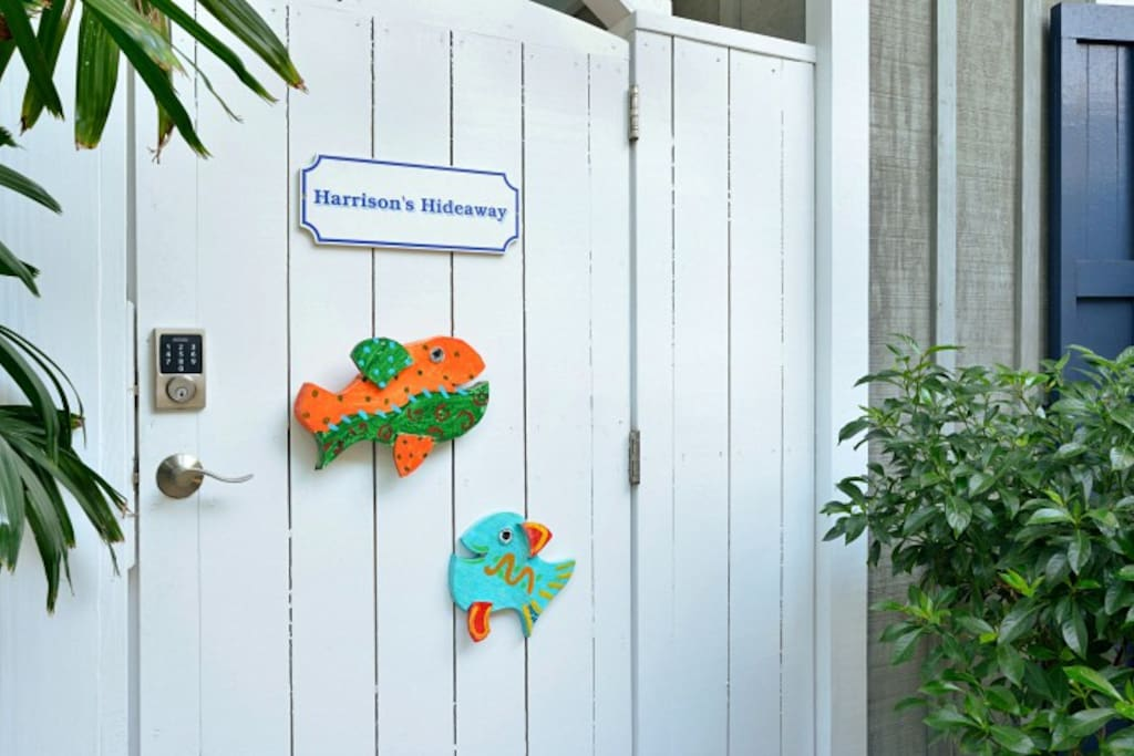 Gate to Harrison's Hideaway with Morris Johnson colorful fish welcoming you!