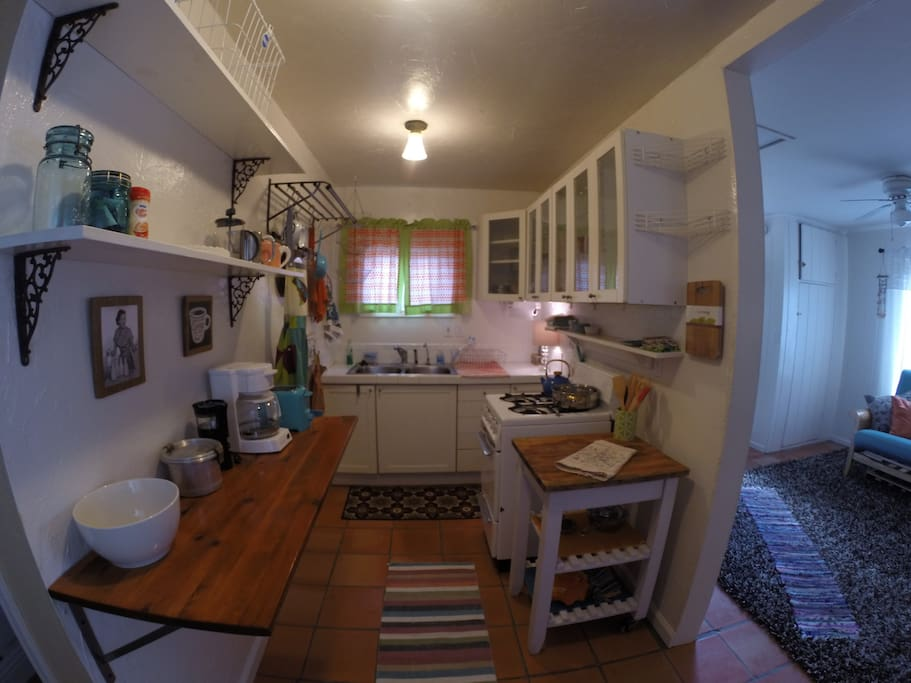 Retro kitchen with full sized fridge, stove, microwave