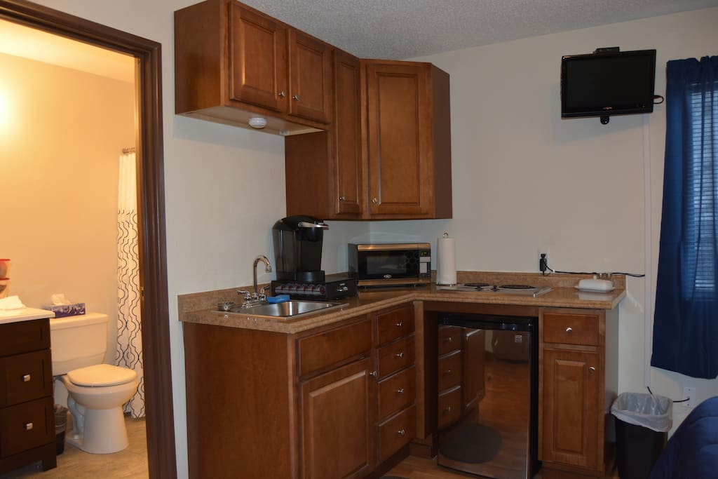 The kitchen has a Keurig, microwave and stainless cooktop.  Perfect for a quick meal.  The TV is on a full motion mount so you can watch it from any corner.