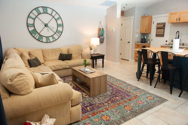 Welcome to our cozy suite! Open concept living room and kitchen allows everyone to be a part of the fun and conversation while relaxing and cooking a delicious home cooked meal.