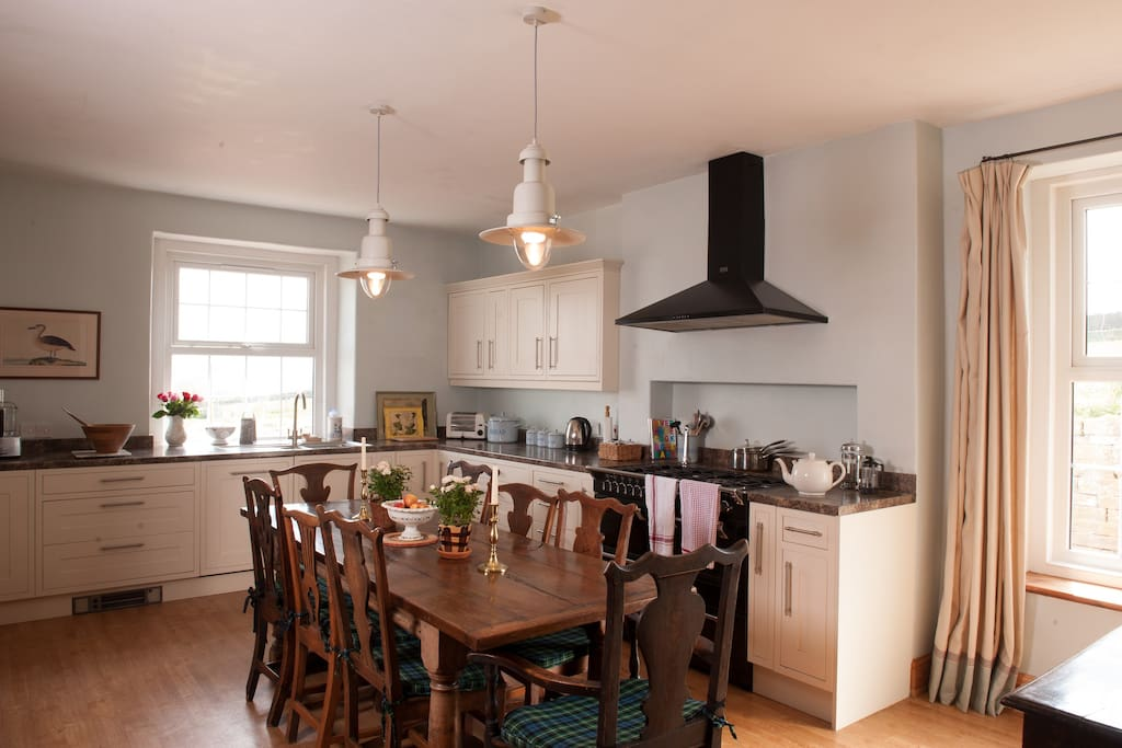 The Farmhouse kitchen with Range cooker and refectory table