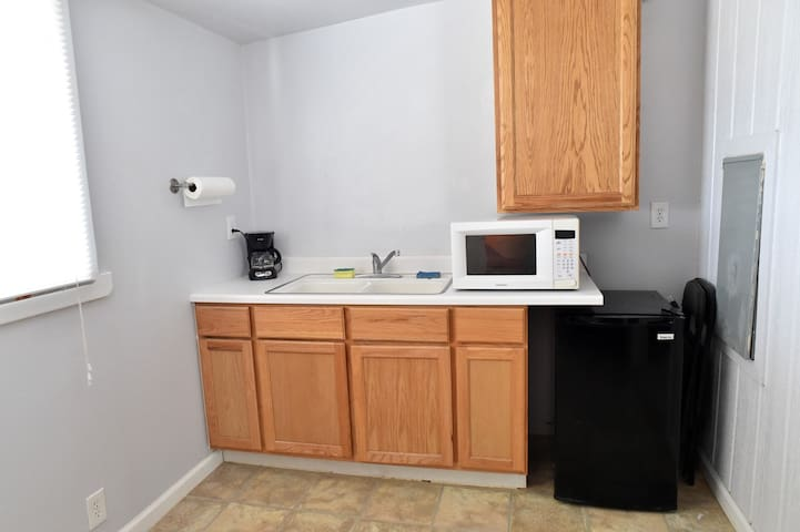 Kitchen includes Coffee Maker and Free Fresh Coffee & Tea, Induction Cook Top, Microwave Oven, Toaster, Refrigerator, Utensils & Cook Ware