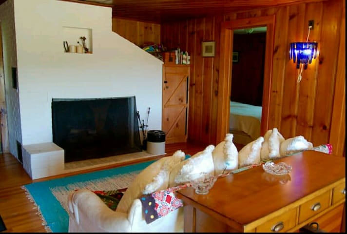 Comfortable sitting area with wood-burning fireplace, perfect for colder months.  (update:  the fireplace is inoperable at this time - sorry!)