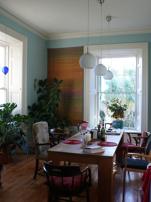 The breakfast table is bright and surrounded by greenery.