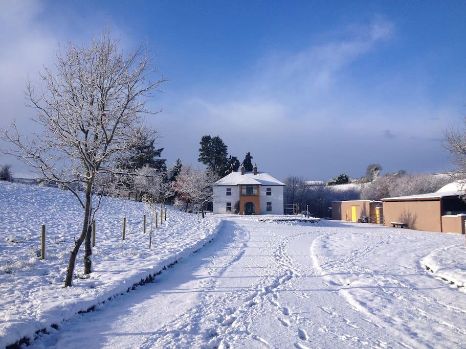 A front view of our farmhouse in winter