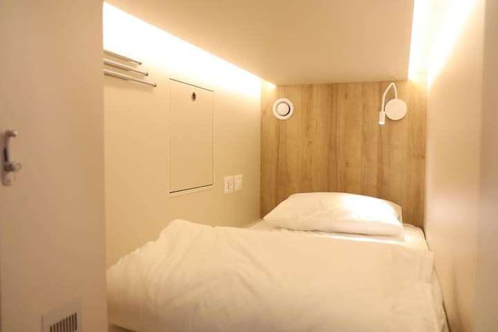 Comfy capsule room in new hotel