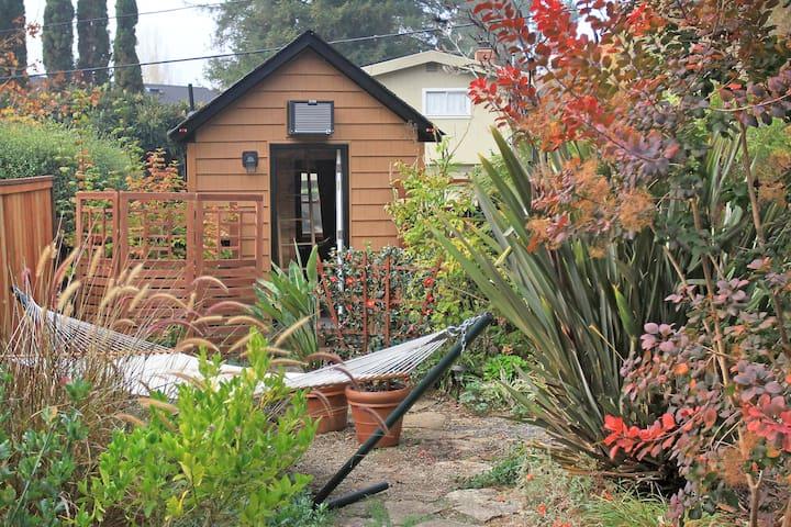 """Enter """"Jenny"""" through a lush private garden."""