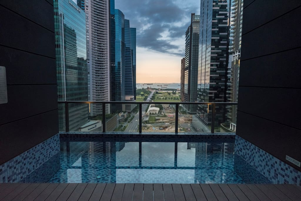 Enjoy a soak in the jacuzzi and take in a view of the modern jungle against the backdrop of the Straits of Singapore