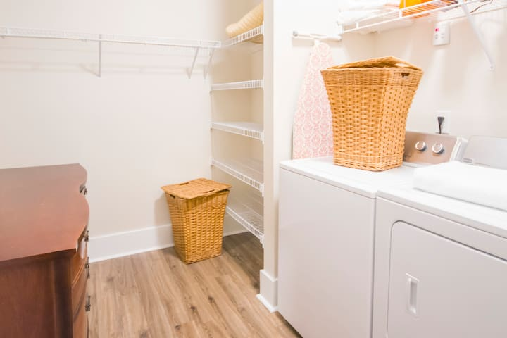 Very large walk in closet with full size washer and dryer.