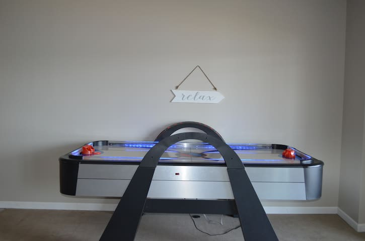 Air hockey table in basement.
