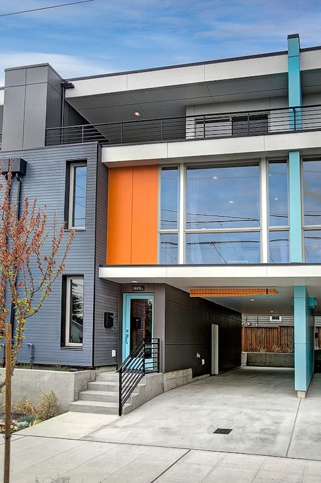Brand new Mid Century Modern Townhouse with eclectic touches and cleanly spaces right in the heart of Ballard!