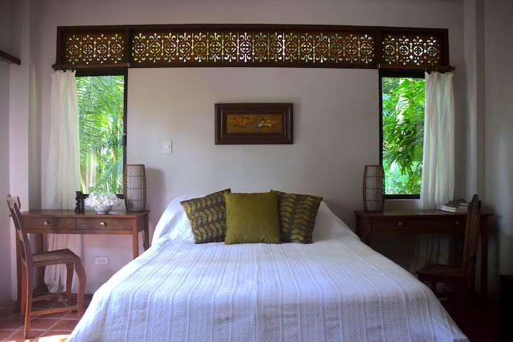The Orchid Suite-tranquil and peaceful -enveloped within the surrounding rainforest.