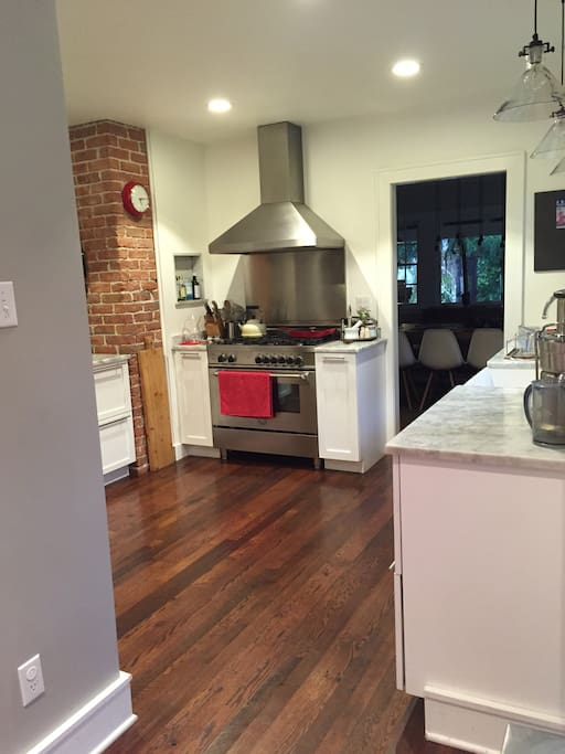 Bright kitchen with gas stove, juice + espresso machines