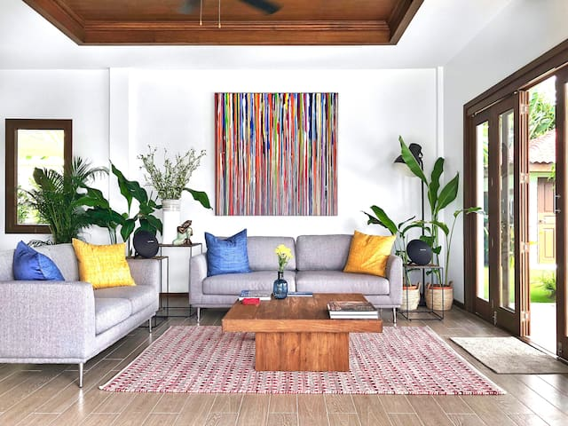 Our spacious living room with stunning pool views and sliding doors on both side is a perfect place to chill while letting the tropical breeze in. Easily connect your favorite music to our high-end wireless Harman/Kardon speaker and let the vacation begin!