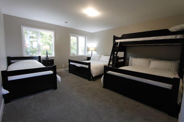 Upstairs bunkroom w/ queen, single and single over queen bunk bed. Ensuite bath.