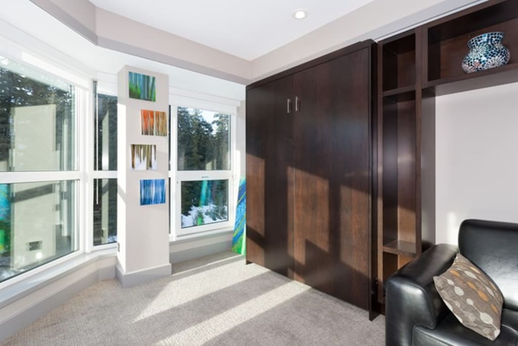 The murphy bed creates lots of room in the living area.