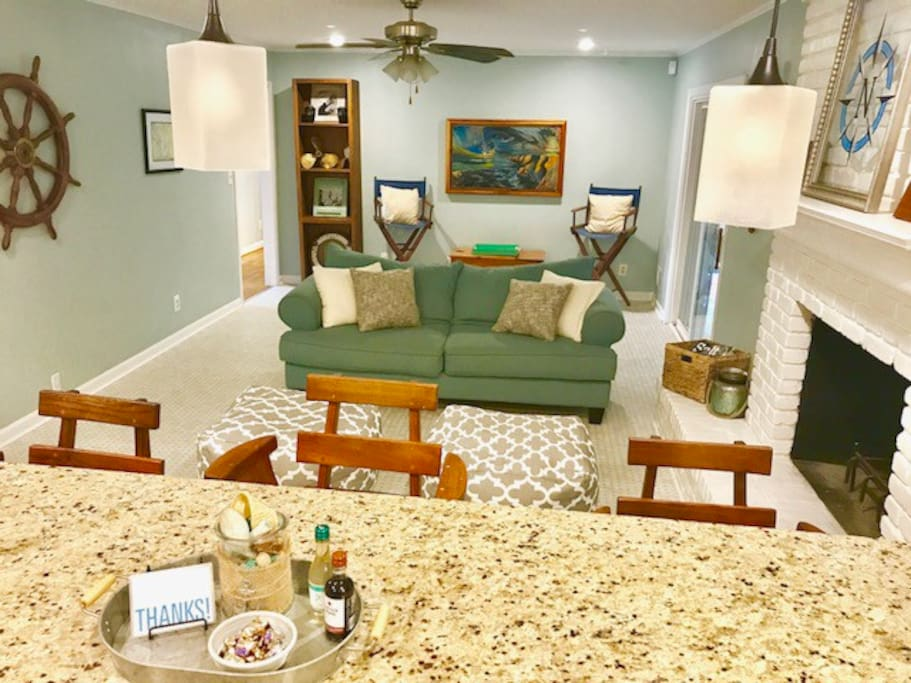 Kick Back and Relax in the open Family room/Eat in Kitchen and Bar!