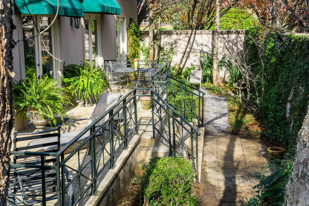 Lush, mature gardens in the courtyard with plenty of space for entertaining or peaceful retreat in the outdoors.
