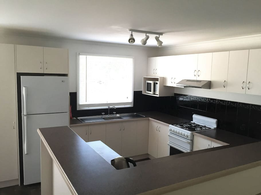 Fully equipped kitchen with relatively new fridge and appliances.