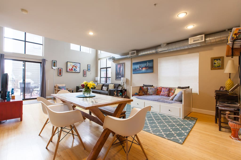 Open living room with ceiling height windows, lots of great light