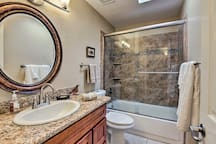 Choose between a shower and bath in the guest bathroom.