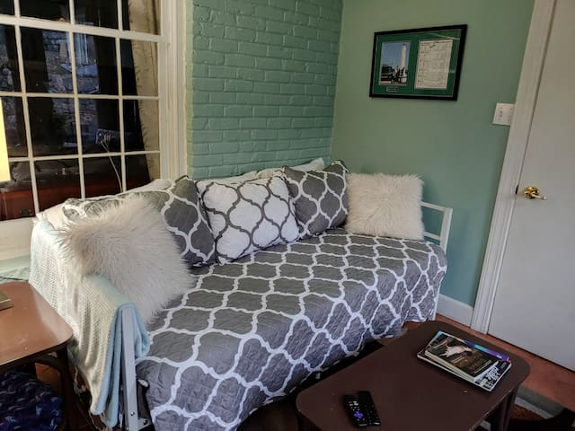 Daybed in sunroom on first floor