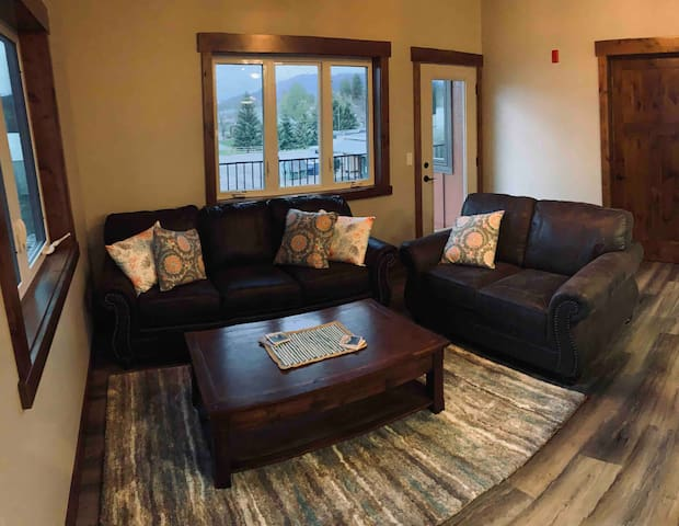"""Comfortable living room awaits to rest and relax. 55"""" roku enabled tv. Sleeper sofa with memory foam for additional guest"""