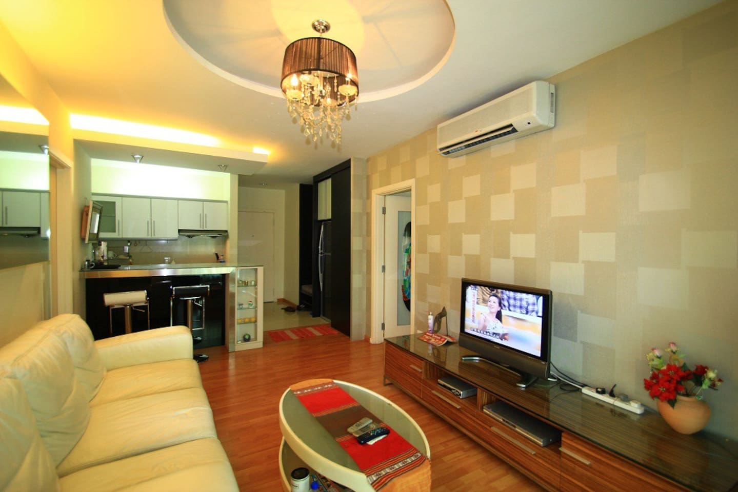 Grand living hall right when you enter from entrance. Stone in the apartment with nice & vibrant TV,under big powerful air con after a long hot day soak in Malaysia weather.