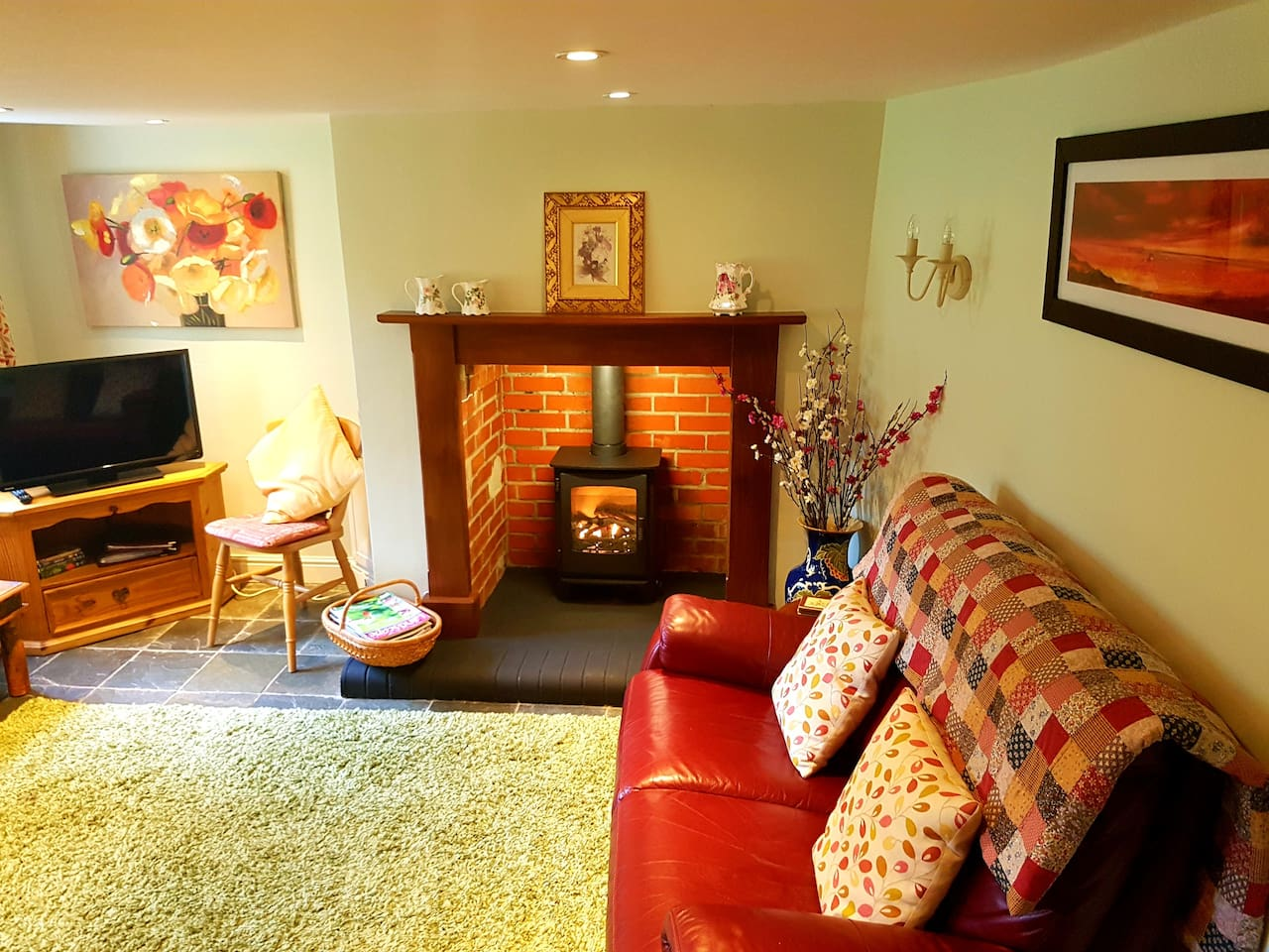 Warm and cosy sitting room with TV/DVD, telephone, gas stove, USB charger point