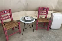 Seating area for two and cooling portable AC unit for summer months