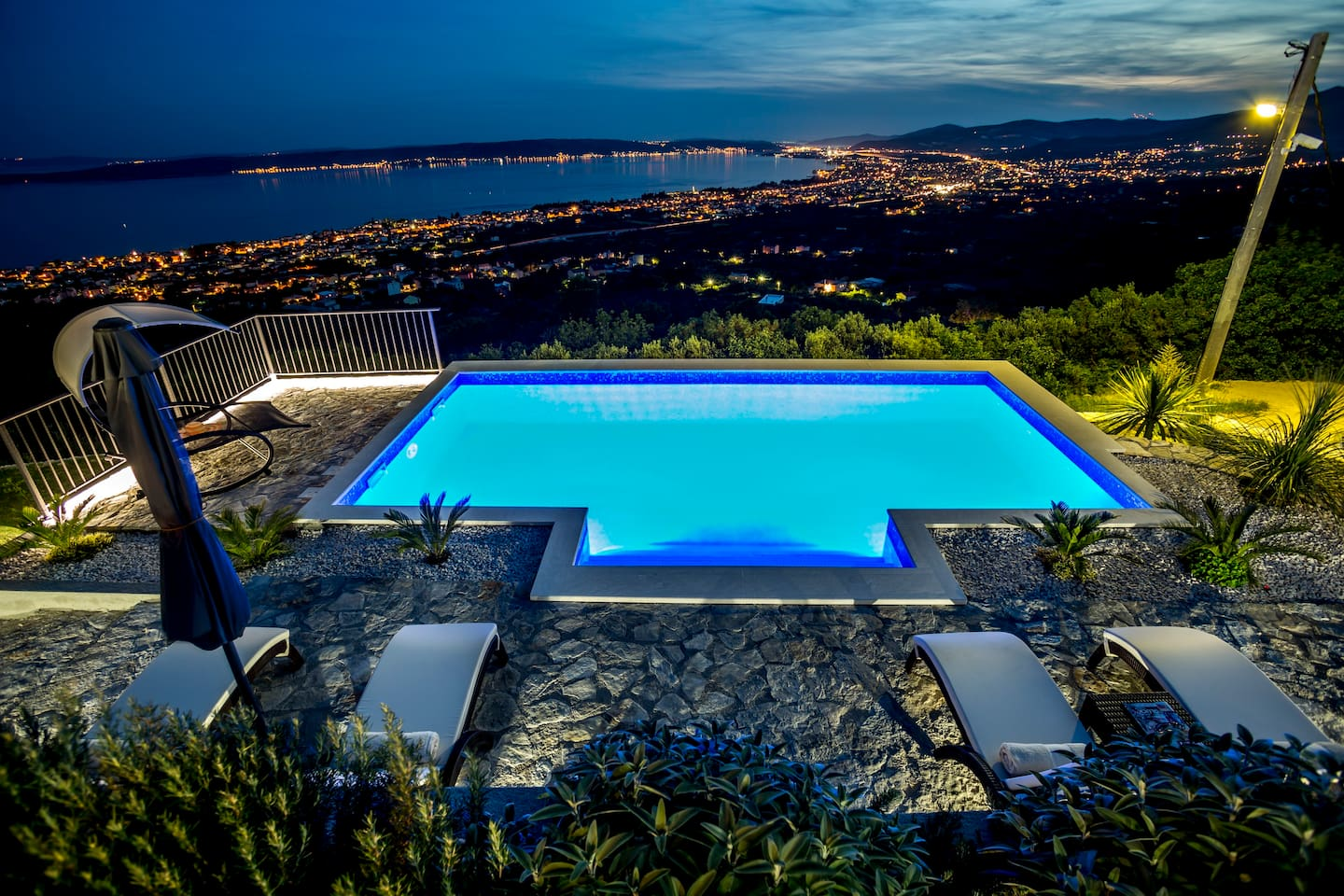 Panoramic view of the sunset and pool lights, nature provides a peaceful and relaxed atmosphere without interaction of neighbors.