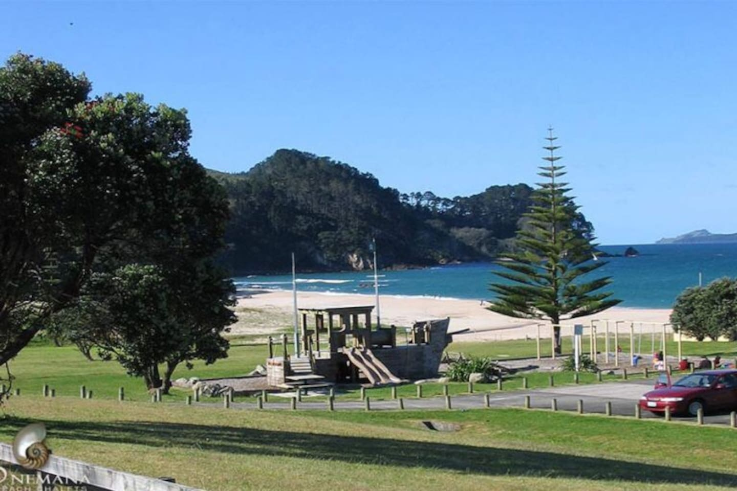 Beautiful secluded Onemana beach with kids play area and beachfront tennis court for anyone's use.