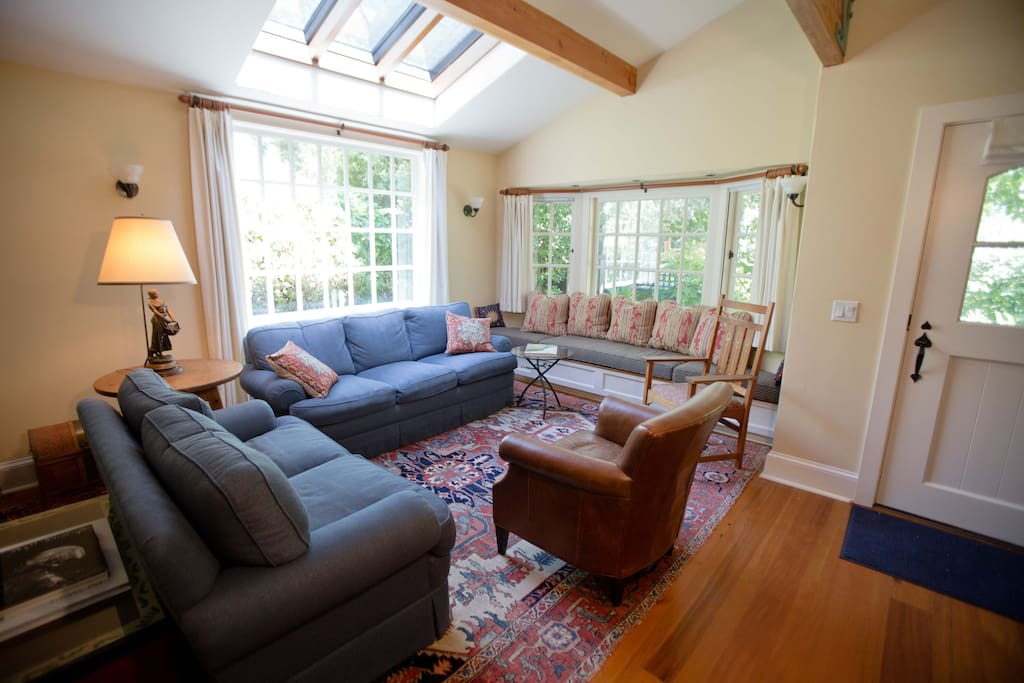 Sunny living room with skylight and bay window