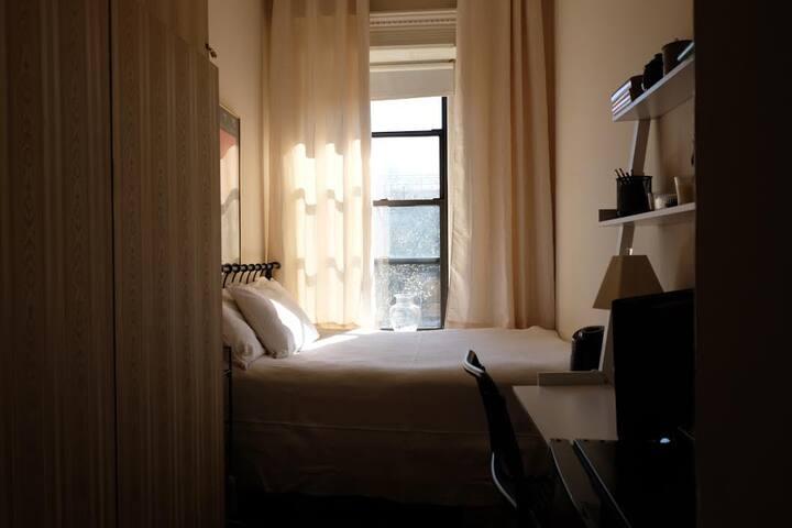 Sunny room on quiet block