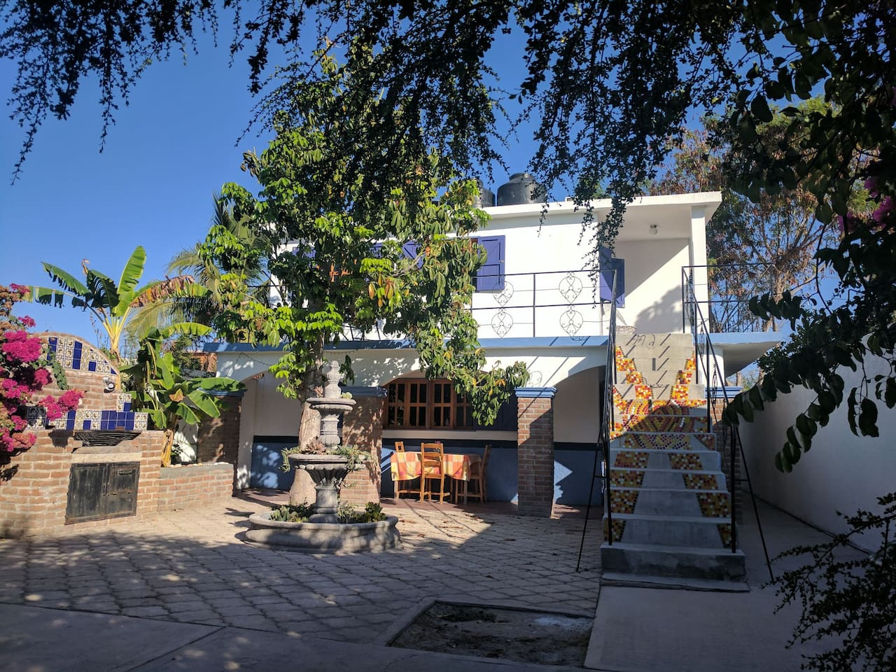The courtyard. Both the upstairs and down stairs units are for rent. This listing is the top of the units.