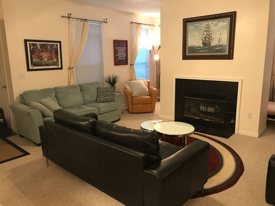 Large family room with multiple chairs & multiple sofas!