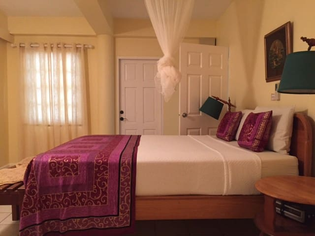 Large bedroom with a COMFY queen bed