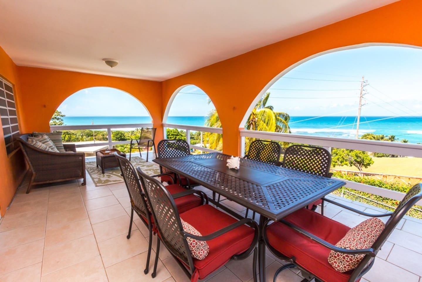 Breezy outdoor living and dining room surrounded by the turquoise sea.  180-degree water views!
