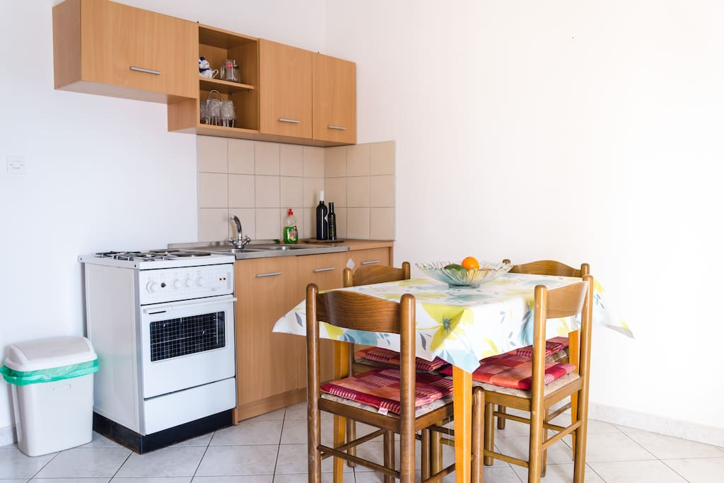 This is the kitchen and living room where the sofa can be modified in a bed for two. The kitchen is fully equipped (including few local spices) for cooking a pleasant meal for up to 6 people. Here is where you can access the balcony.