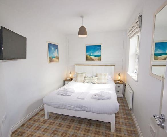 Master Bedroom with TV and ensuite shower room
